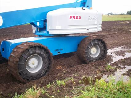 Genie lift with custom made tracks on tires