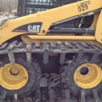 Image of skid steer trackson snow