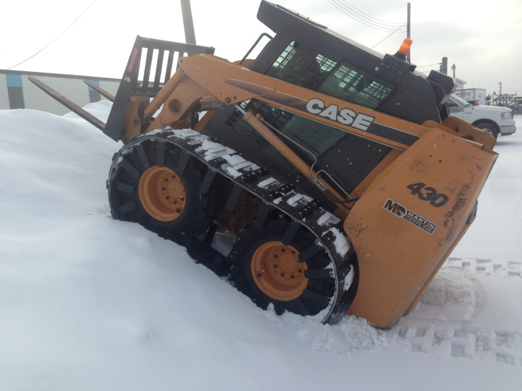 Image of skid steer tracks for sale and skid loader tracks on a Bobcat.