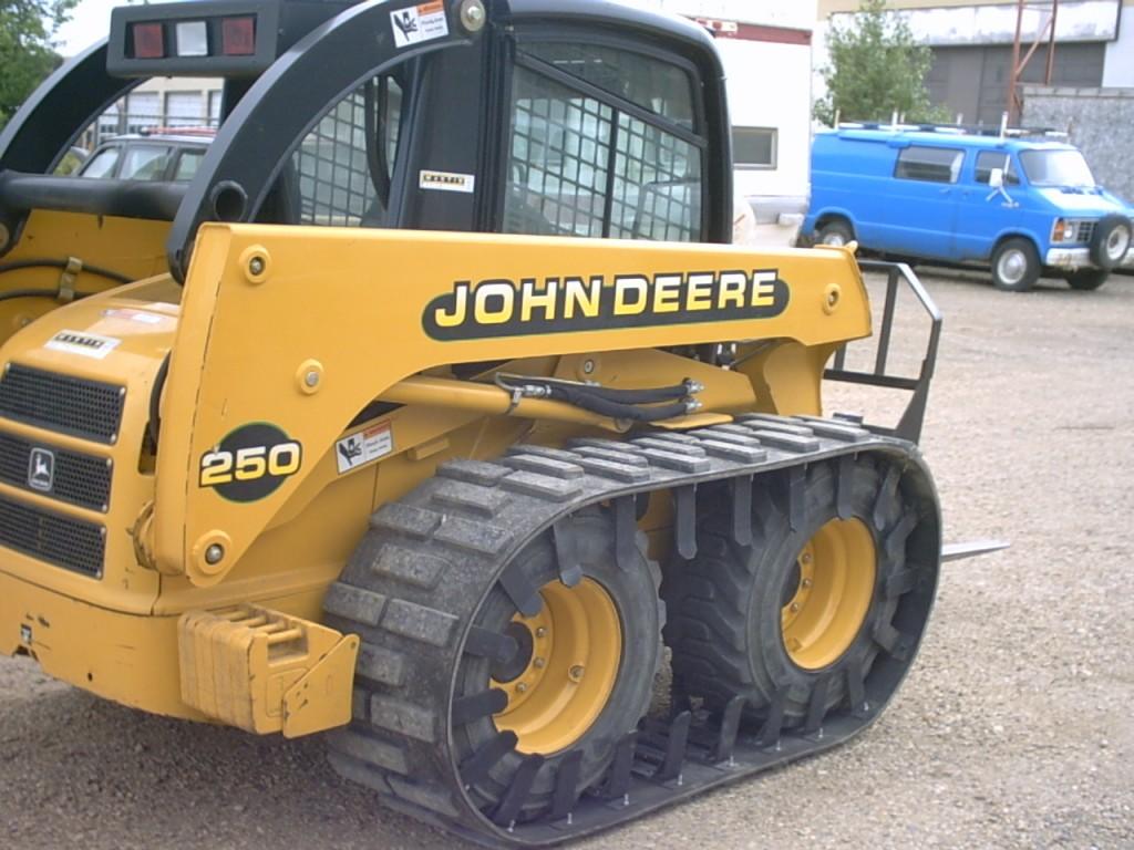 Custom skid loader tracks on a John Deere