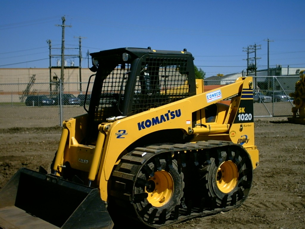Skid Steer Tracks : Skid steer track conversion right systems int