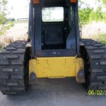 Image of skid loader tracks on a Bobcat.