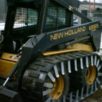 New Holland L885 With Custom Tracks
