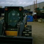 Image of skid steer tracks on loader