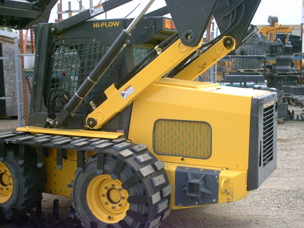 skid loader tracks on machine