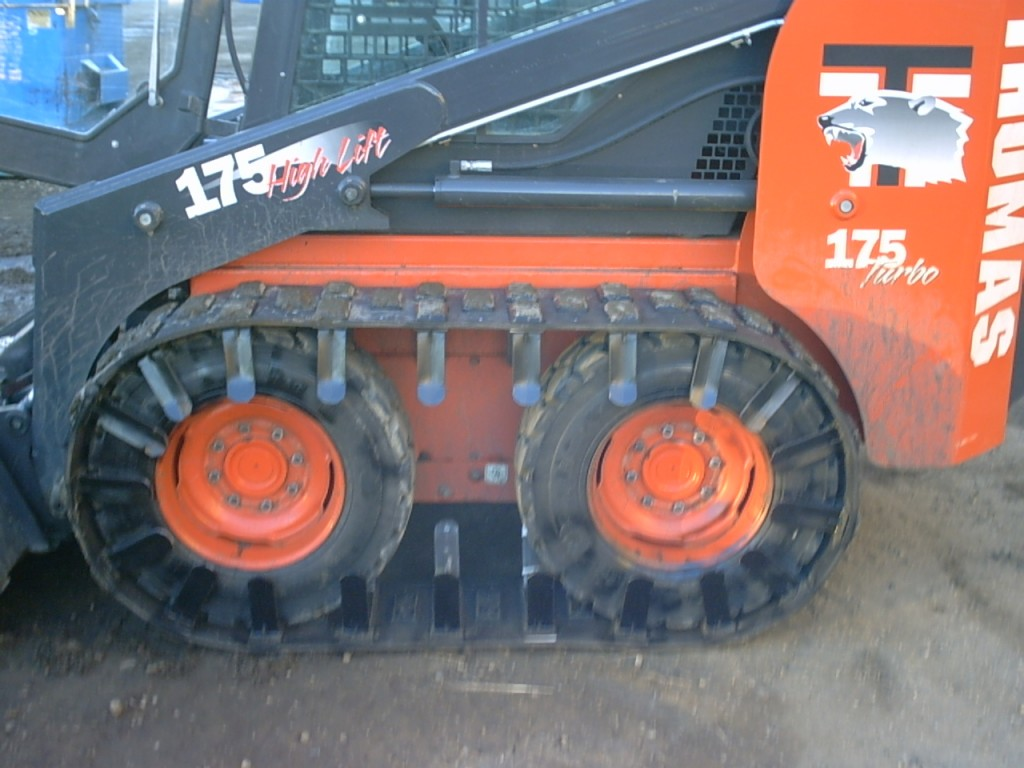 skid steer tracks installed