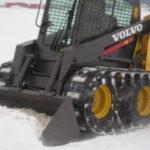 Image of skid steer tracks for sale and skid loader tracks on a Bobcat.