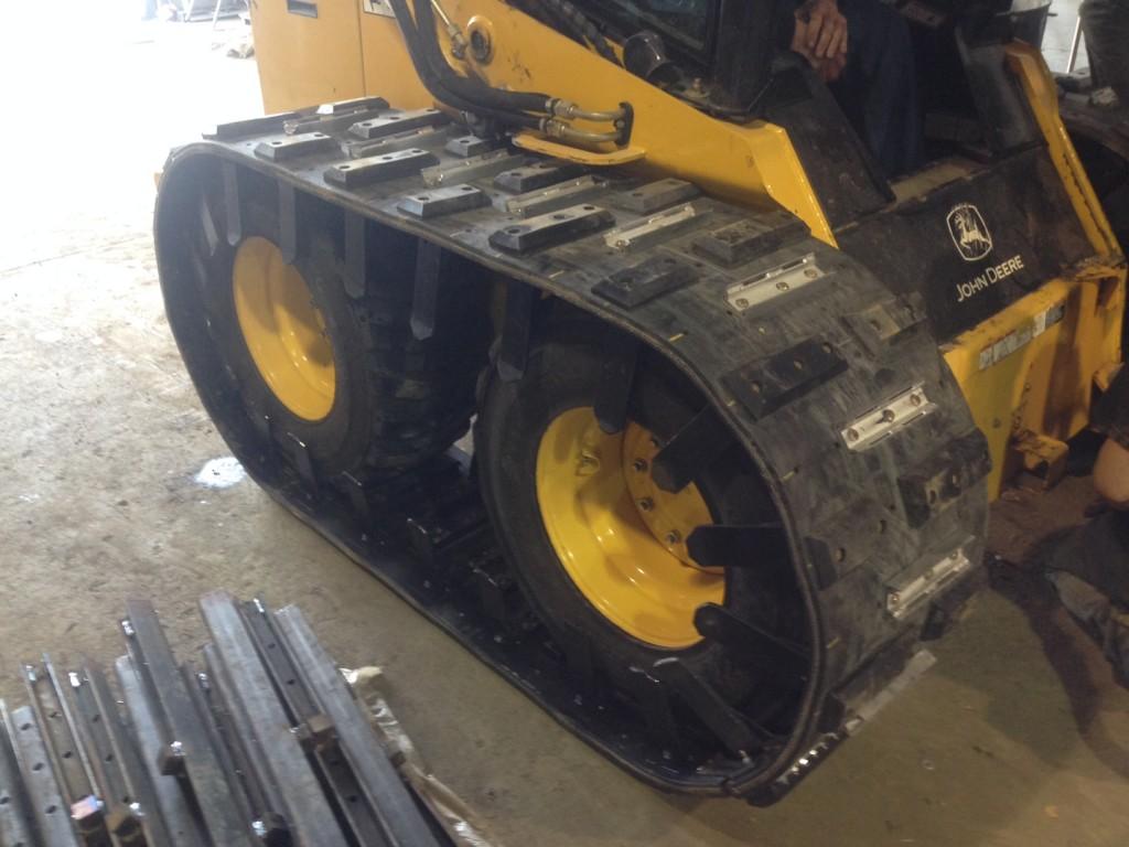 Image of tracks for skid steer loaders and snow tracks for skid steer.