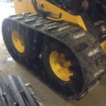 Image of tracks for skid steer loaders and snow tracks for skid steer.